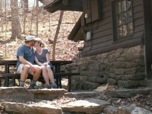 Us, kissing in front of our cabin. Someday I want to go back there.